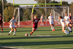 Midfielder Eva Bowen tees up a shot in the opening minutes of the second half against Loveland.