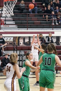 Brooke Painter shoots a three pointer in an offensive barrage against Seton.