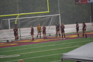 JV Gold sets up to defend a corner kick against Mercy McAuley. Kira Geis, #6, cleared the ball off the line to preserve a scoreless second half.