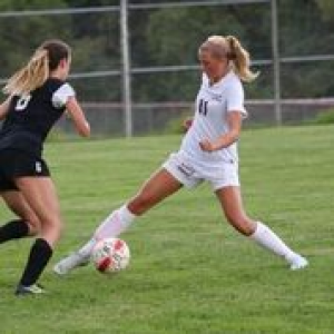 Claire Studenka cuts around a Milford defender on her way to goal.