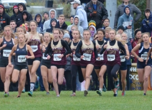 Lady varsity runners at the start of the ECC Championship