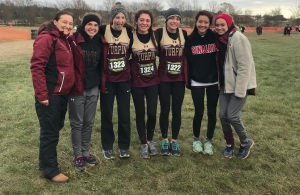 cross country runners pose with their coach, Missy Siemers, at the state meet